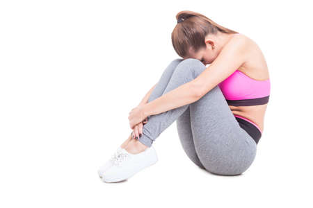 Young female stretching her spine after workout isolated on white background with copy text space