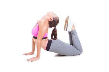 Young woman wearing sportswear stretching her spine isolated on white background with copy text space Stock Photo
