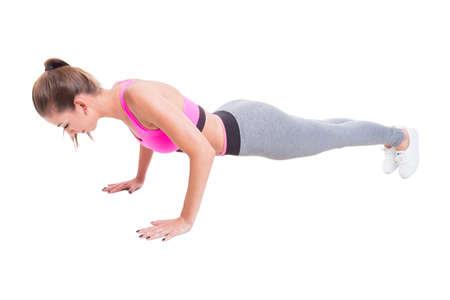 out of body: Full body of fit girl doing push-up for working out isolated on white background