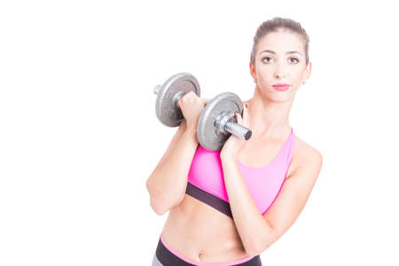 heavy weight: Fit girl holding heavy weight looking bored isolated on white background with copy text space Stock Photo