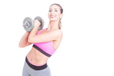 heavy weight: Girl working out holding heavy weight and smiling isolated on white background with copy text space Stock Photo