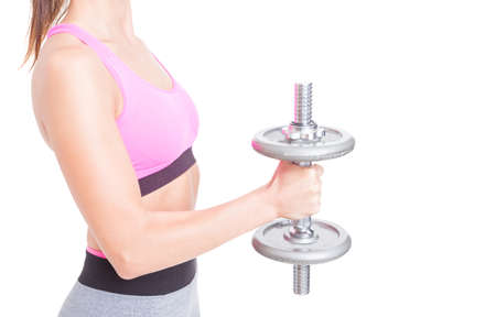 Close-up of girl arm holding heavy weight at gym isolated on white background