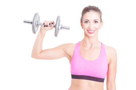 levantar peso: Female trainer holding up one heavy dumbbell isolated on white background with copy advertising area Foto de archivo