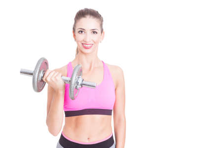 heavy weight: Fit girl posing holding heavy weight at gym isolated on white background with copy advertising area Stock Photo
