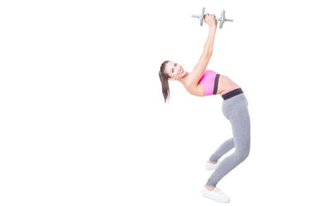 Girl at gym bending back holding weight isolated on white background with copy text space