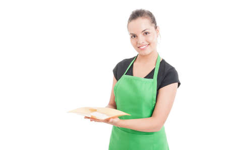 storekeeper: Friendly young saleswoman woman holding empty plate as food concept isolated on white background with copyspace Stock Photo