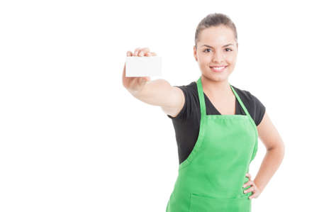 Happy smiling employee handing blank visit card with text area isolated on white background