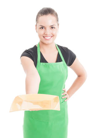 storekeeper: Beautiful smiling employee offering empty plate or dish isolated on white background