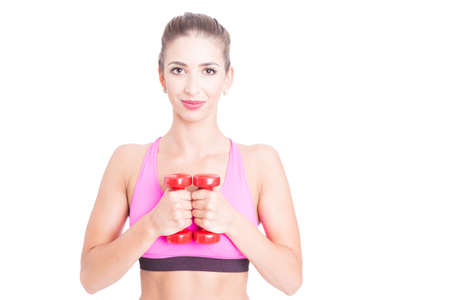 Fit woman holding a pair of red dumbbells isolated on white background with copy text area