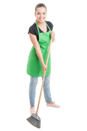 housemaid: Cheerful cleaning woman brushing the floor as housemaid concept isolated on white Stock Photo