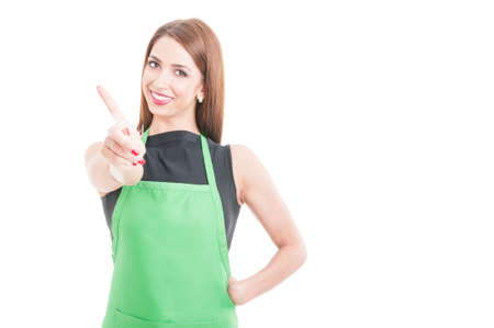 refusal: Saleswoman doing refusal gesture with her index finger on white studio background with copy space