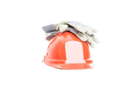 safety gear: Safety gear kit with helmet and gloves for construction activity isolated on white background Stock Photo