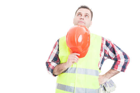 Pensive male constructor looking for solution to a problem isolated on white background with text area Standard-Bild