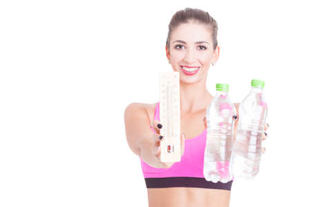 Selective focus of girl at gym holding water and thermometer like being hot isolated on white background with copy text space