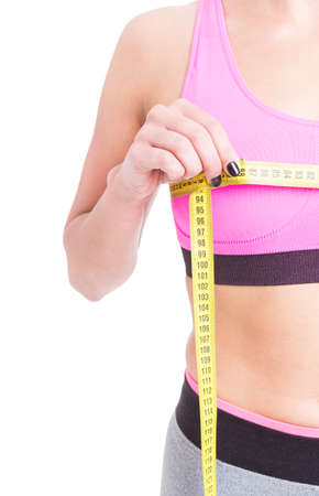 Side view of woman measuring her bust line isolated on white background Stock Photo