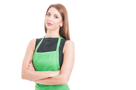 Confident pretty employee standing with arms crossed as successful seller concept isolated on white with advertising area