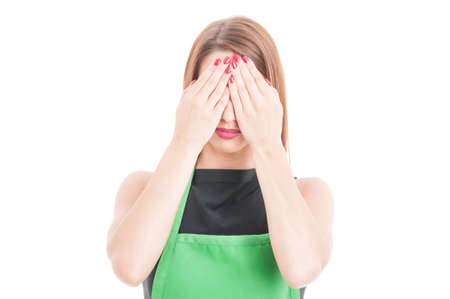 See no evil concept with young employee with apron isolated on white background Stock Photo