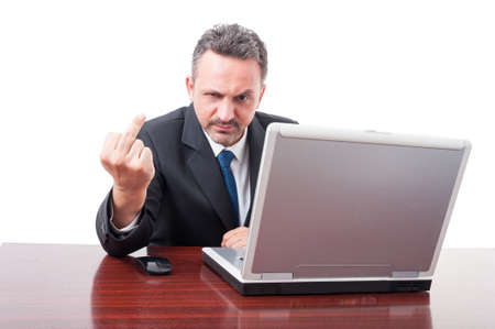 obscene: Rude business person doing obscene gesture with middle finger on white studio background Stock Photo