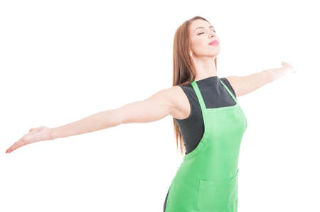 Happy young saleswoman with arms wide open celebrating victory isolated on white with copyspace Stock Photo