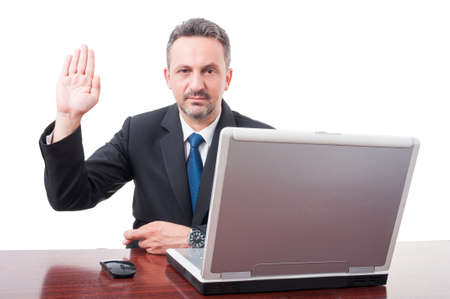 Serious male manager doing a false testimony and holding fingers crossed isolated on white background