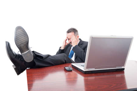 exhaustion: Stressed executive ceo sitting in his office trying to relax as exhaustion concept isolated on white background Stock Photo