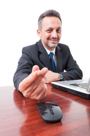 corporate greed: Businessperson on desk doing money gesture as payment concept isolated on white background