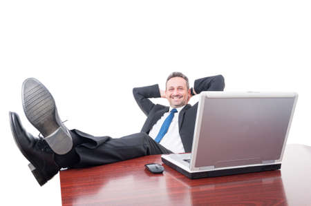 office shoes: Smiling manager relaxing at the office with his shoes on the desk isolated on white
