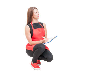 Hypermarket saleswoman with red apron doing inventory isolated on white with copyspace