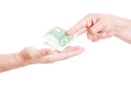 Male hand in close-up receiving bribe from another person isolated on white background Stock Photo