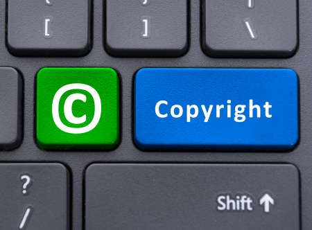 Copyright text and symbol button on keyboard as trademark protection and legacy concept