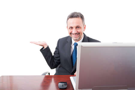 Young businessman showing empty copyspace on white background