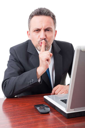 shush: Young lawyer making silence or shush gesture on white background Stock Photo