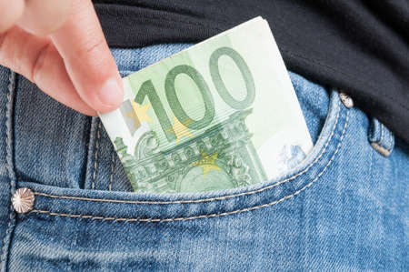 cash money: Closeup of euro money in somebodys jeans pocket