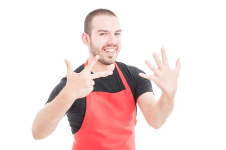 Happy hypermarket seller in uniform showing eight fingers isolated on white background
