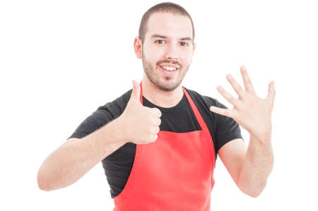 Attractive supermarket employee showing number six on white studio background Stock Photo