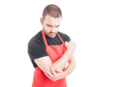 rheumatism: Supermarket young employee having elbow inflammation as rheumatism concept isolated on white background