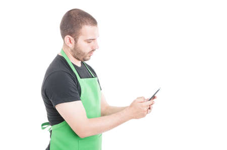 retailer: Hypermarket seller texting on smartphone isolated on white background with advertising area