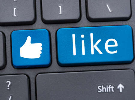 like button: Keyboard with blue like button icon in close up as social media concept