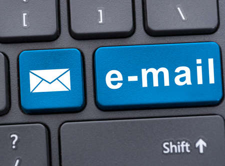 wireles: Closeup picture of email button with message on keyboard of modern laptop