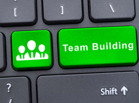 companionship: Creative group cooperation concept with team building text on laptop keypad