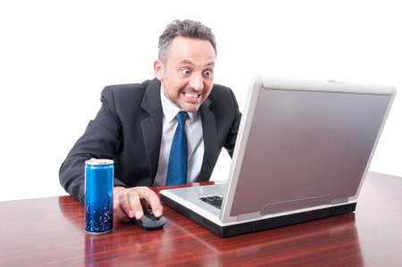 psychotic: Man at office with psychotic look having energy drink isolated on white background with advertising area