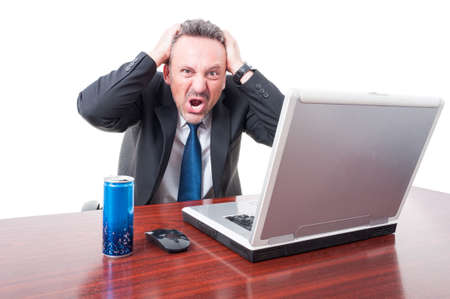 Man at office being psychotic with energy drink aside isolated on white background Stock Photo