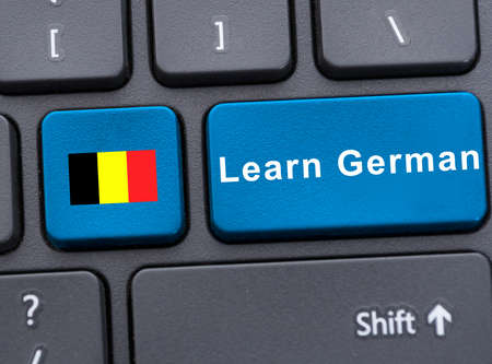 deutsch: Closeup key with deutsch flag and learn german button on keyboard Stock Photo
