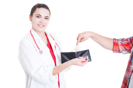 doctor putting money: Patient hand putting money in female doctor wallet as medical bribery concept isolated on white
