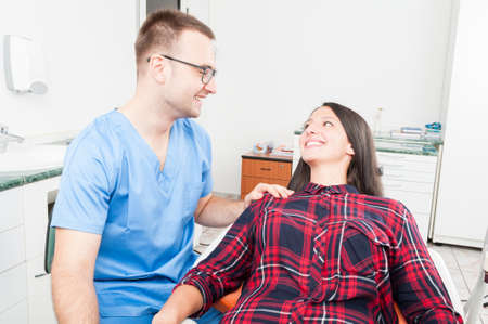 trustworthy: Hygienist holding patient as being trustworthy and smiling