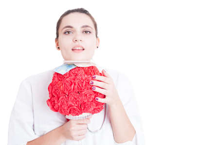 Pretty female medic with paper flower bouquet, euros and credit card isolated on white background with advertising area