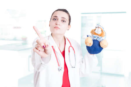 refusal: Medical pediatric woman doing refusal or forbidden gesture as wrong child treatment concept