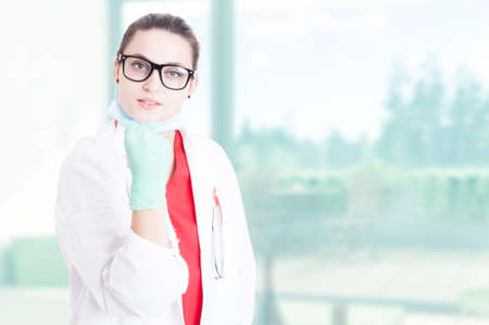 area of conflict: Pretty doctor with spectacles showing fist as conflict concept with text area