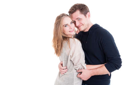 Attractive couple posing as being happy and joyful wearing autumn clothes isolated on white background with copy text space