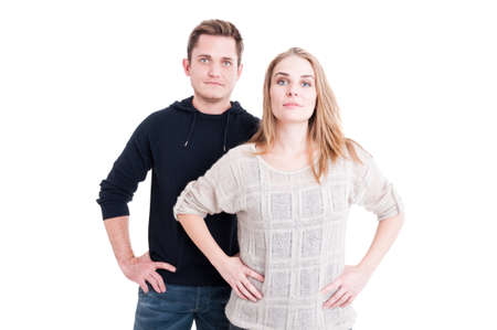 Couple posing and standing with arms on hips looking confident isolated on white background with copy text space